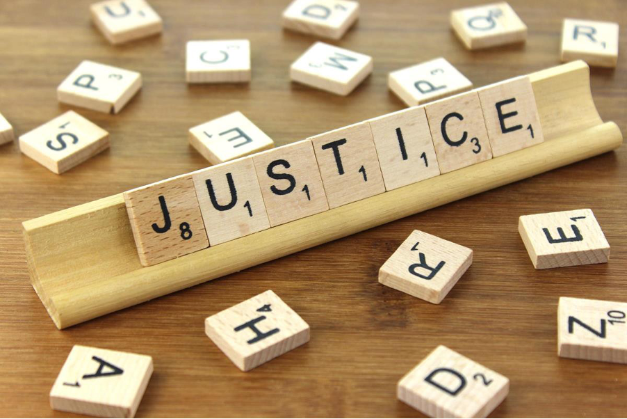 scrabble letters spelling the word 'justice'